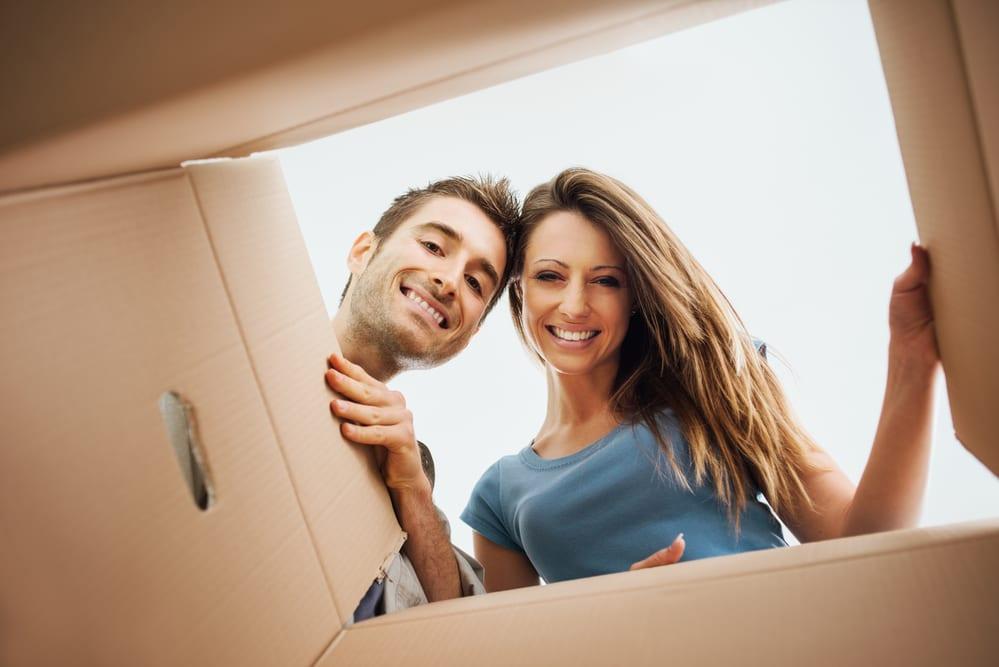 couple looking inside a cardboard box